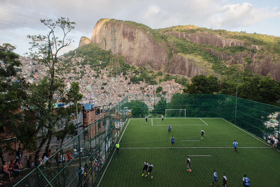 Rocinha, the largest and the most populous favela in Brazil, located in Rio de Janeiro's South Zone between the districts of Sao Conrado and Gavea, hosts her own World Cup 2014 as the FIFA World Cup 2014 goes on in 12 different Brazilian cities, June 23, 2014. The semi-finals were held on a hilly pitch since the favela is on a very steep hill, with many trees surrounding it. Photo: Anadolu Agency, Wire Photos / 2014 Anadolu Agency