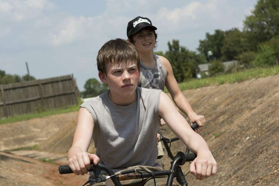 "Josh Wiggins (front) plays 13-year-old Jacob and is the title character in ""Hellion."" He and his father want his little brother back. Photo: IFC Films"