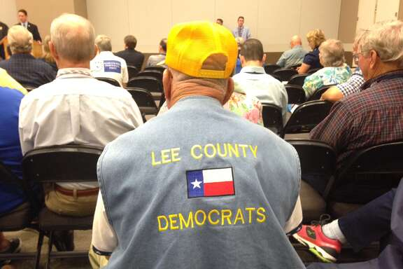 "An attendee in the Non-Urban/Blue Dog caucus wears a jean vest emblazoned with ""Lee County Democrats"" at the Texas Democratic Convention in Dallas on Friday, June 27, 2014."