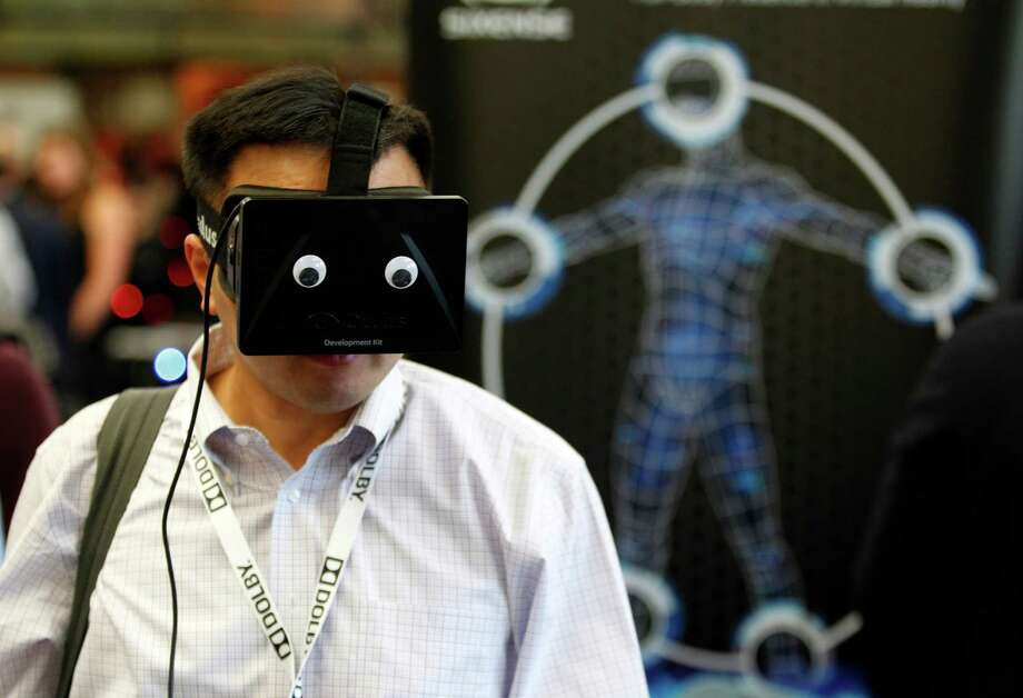 Bin Shen of Verizon dons an Oculus Rift prototype headset, adorned with googly eyes, at the Entertainment Technology in the Internet Age conference this month at Stanford University. Photo: Beck Diefenbach, Contributor / ONLINE_YES