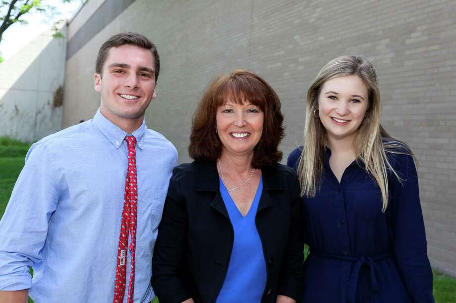 Edward Bossidy and Michaeleen McKinley, New Canaan High School class of 2014 graduates, received a  Strength In Numbers Scholarship Award from Reynolds & Rowella, LLP, which has an office in New Canaan. With them, Janice Kunst. tax manager at Reynolds & Rowella. Photo: Contributed Photo, Contributed / New Canaan News