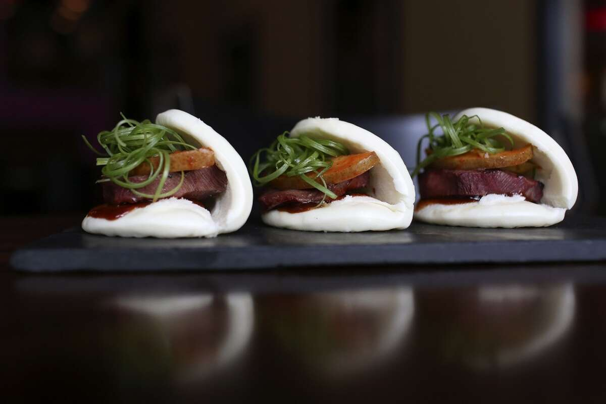 The steamed pork buns are available during happy hour at Umai Mi.