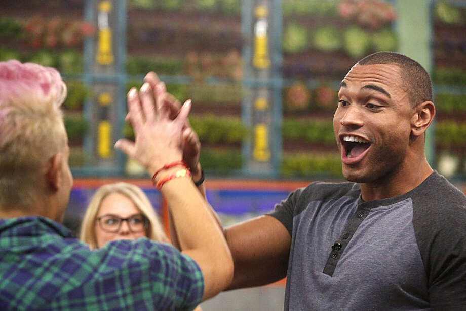 Houseguest Devin gives a high five to Frankie on the season premiere of BIG BROTHER, Wednesday, June 25 (8:00 -- 9:00 PM, ET/PT) on the CBS Television Network.  Photo: Cliff Lipson, ©2014 CBS Broadcasting, Inc. All Rights Reserved / ©2014 CBS Broadcasting, Inc. All Rights Reserved