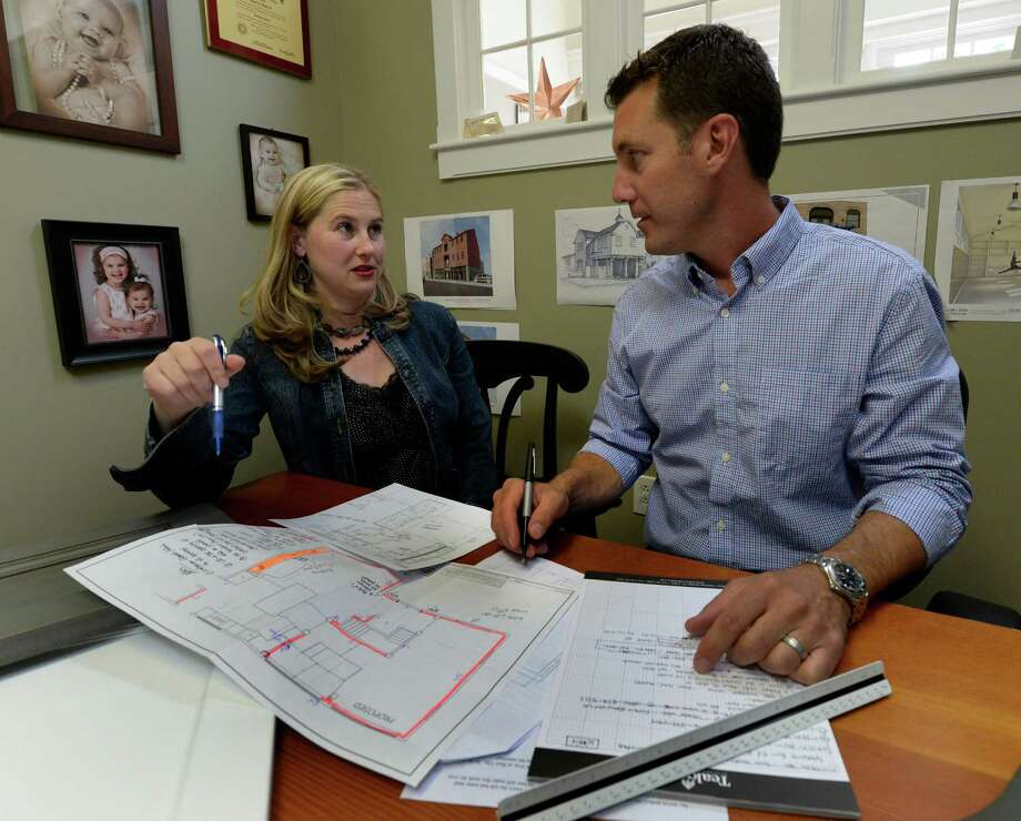 Jim Sasko president of Teakwood builders speaks with designer Eva Anderson Monday afternoon, June 23, 2014, at their offices in Saratoga Springs, N.Y.     (Skip Dickstein / Times Union) Photo: SKIP DICKSTEIN / 00027468A