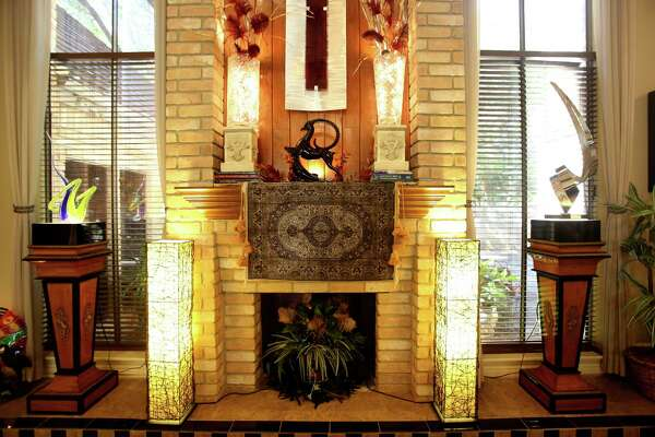 An Islamic prayer rug with about 600 knots per inch hangs over the fireplace in the home of Linda and James Beard. The Beards found the rug in Egypt.