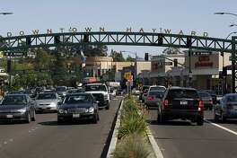 """Traffic moves along newly designed Foothill Blvd. in Hayward, CA, Wednesday May 28, 2014. Caltrans recently reconfigured the streets in downtown Hayward into what is being called the """"Hayward Loop"""",  to help ease the flow of 100,000 cars that daily use Hayward as a shortcut between points East and Silicon Valley."""