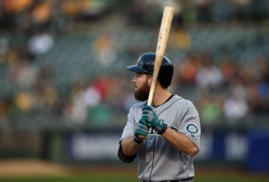 Dustin Ackley, left fielder  Grade: C  2014 stats: 70 games, .222 average, 52 hits, 27 RBIs, 4 homers, 42 strikeouts, 0 errors  Ackley has handled the switch to left field well, committing no errors, though he may be baseball's least graceful outfielder. But he has still struggled   at the plate, and his batting average is plummeting. Photo: Thearon W. Henderson, Getty Images
