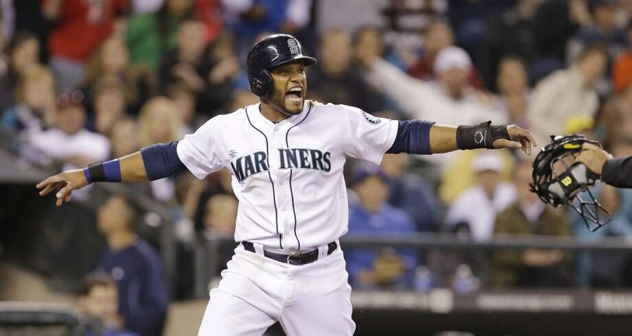 Robinson Cano, second baseman  Grade: A  2014 stats: 75 games, .324 average, 94 hits, 43 RBIs, 4 homers, 36 strikeouts, 3 errors  Seattle's $240 million man is earning his paycheck, leading the Mariners in hitting and ranking second in the A.L. The only reason he doesn't earn an A+   is because of his home-run numbers. Photo: Elaine Thompson, Associated Press