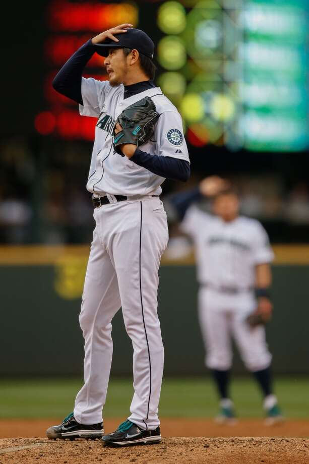 Hisashi Iwakuma, starting pitcher  Grade: B  2014 stats: 11 games, 5-4 record, 3.48 ERA, 55 strikeouts, 8 walks, 10 earned runs  Iwakuma got a late start to the season after injuring his finger before spring training, yet returned to All-Star form when he joined the rotation in May.   He has struggled lately but remains one of Seattle's most dependable pitchers. Photo: Otto Greule Jr, Getty Images