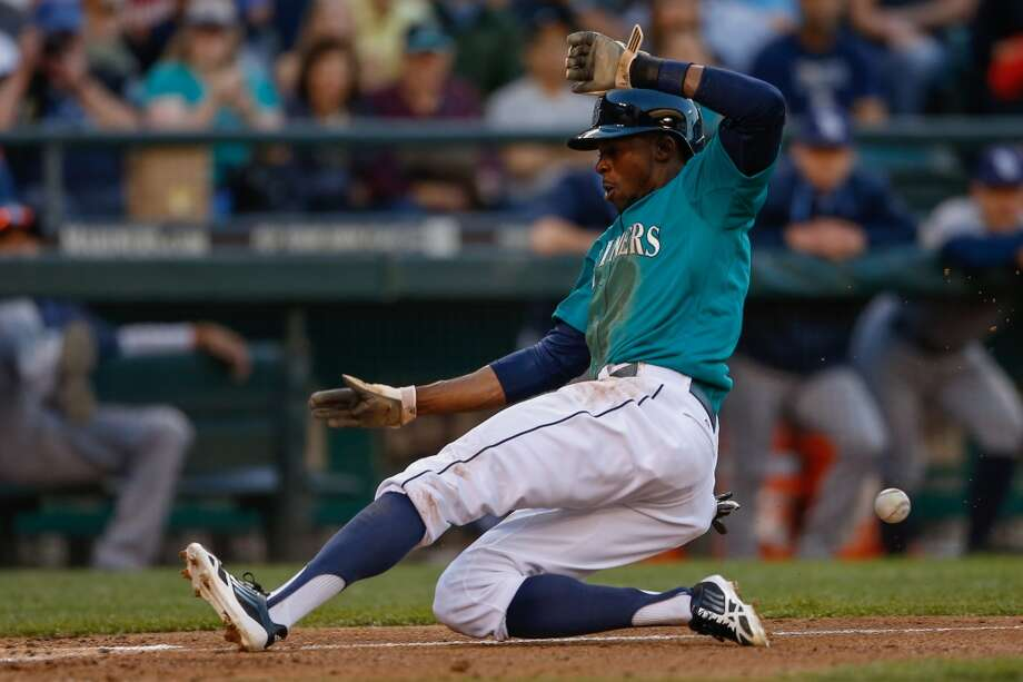 James Jones, center fielder  Grade: A-  2014 stats: 51 games, .280 average, 51 hits, 6 RBIs, 0 homers, 32 strikeouts, 1 error  Jones has been a surprise rookie sensation. The speedster leads the Mariners by far with 14 stolen bases, and is averaging one hit per game. Heck, he is   ranked second among Seattle's regular starters with a .280 batting average. Photo: Otto Greule Jr, Getty Images
