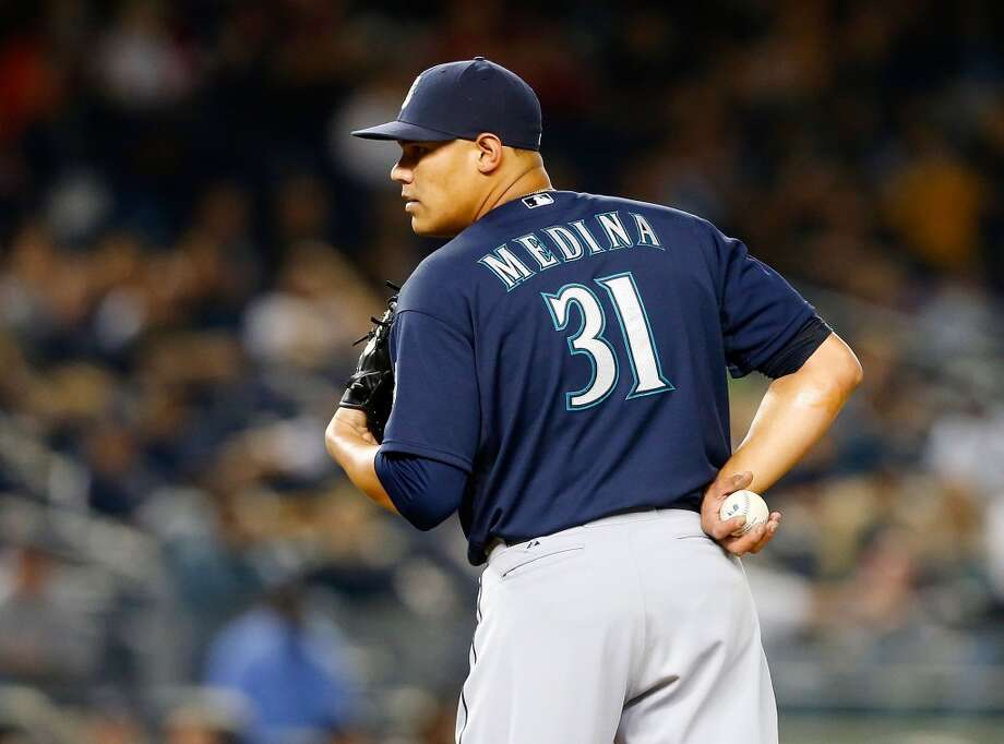 Yoervis Medina, relief pitcher  Grade: A-  2014 stats: 32 games, 4-1 record, 2.48 ERA, 30 strikeouts, 13 walks, 8 earned runs  Consistent, solid, dependable, nasty -- these are all words that describe Medina's pitching. Generally used as a set-up man for closer Fernando Rodney,   Medina is doing his job and doing it well. Photo: Jim McIsaac, Getty Images