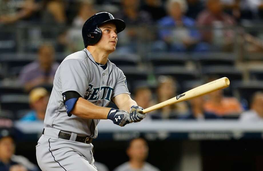 Kyle Seager, third baseman  Grade: A-  2014 stats: 76 games, .267 average, 75 hits, 54 RBIs, 12 homers, 60 strikeouts, 7 errors  Always dependable, Seager has asserted himself as one of Seattle's stars. His batting average jumped 18 points in the past six games, but it's still lower   than it should be for a guy who leads the team in RBIs and home runs. Photo: Mike Stobe, Getty Images