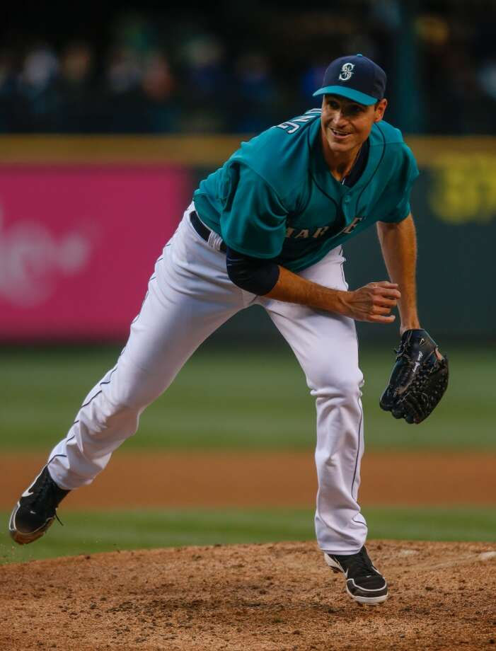 Chris Young, starting pitcher  Grade: B+  2014 stats: 15 games, 6-4 record, 3.23 ERA, 43 strikeouts, 34 walks, 31 earned runs  The M's didn't sign him until two days before Opening Day -- and it sure turned out to be a great signing. Young came from out of nowhere to be a solid   No. 4 starter this year, after sitting 2013 out with a neck injury. Photo: Otto Greule Jr, Getty Images