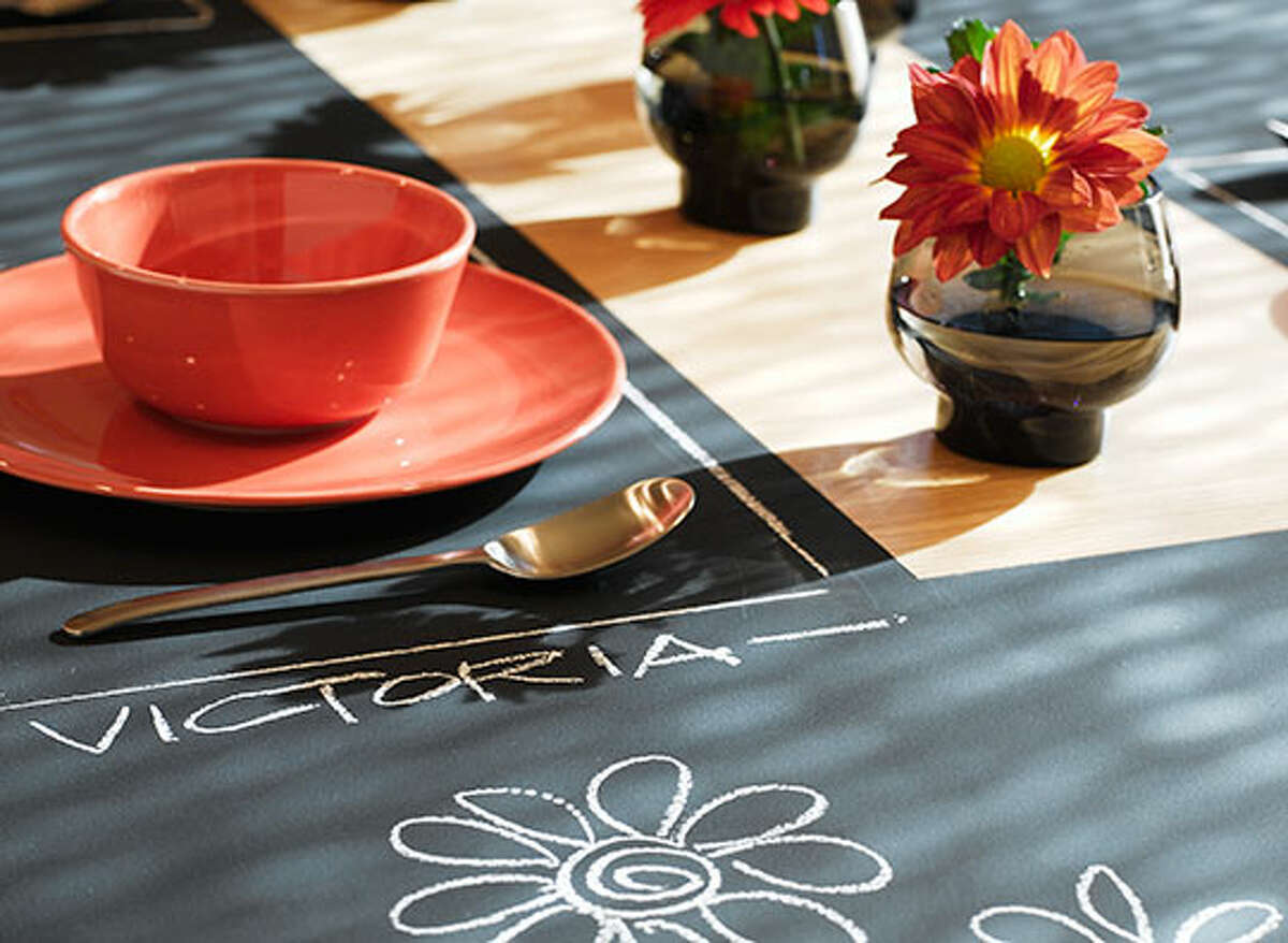 Chalkboard paint can make the dinner table into a tabletop canvas for creating personalized place settings for guests or writing messages to family members.