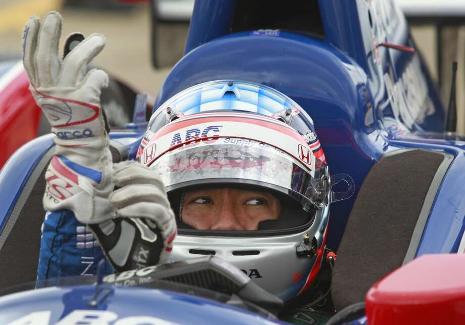 IndyCar driver Takuma Sato puts on his gloves  during an IndyCar practice session for the Grand Prix of Houston at NRG Park Friday, June 27, 2014, in Houston. ( Melissa Phillip / Houston Chronicle ) Photo: Melissa Phillip, Houston Chronicle