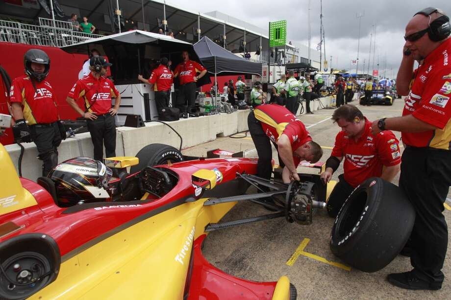 The crew for driver Sebastian Saavedra works on his car during an IndyCar practice session at the Grand Prix of Houston at NRG Park Friday, June 27, 2014, in Houston. ( Melissa Phillip / Houston Chronicle ) Photo: Melissa Phillip, Houston Chronicle