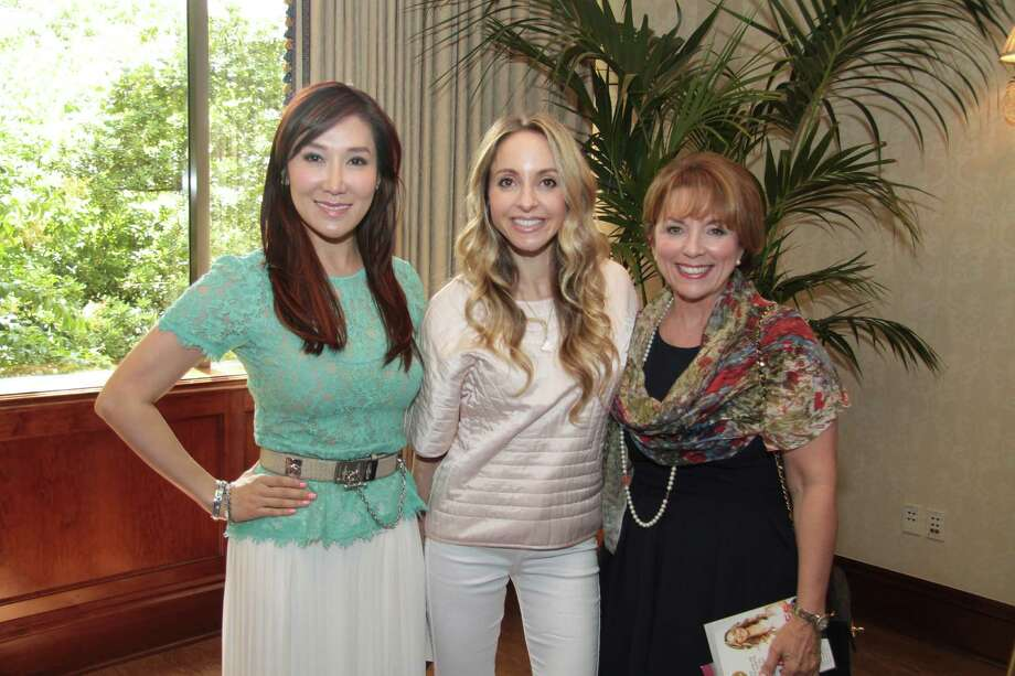 Robin Mueck, right, is shown with Mandy Kao and Gabrielle Bernstein.