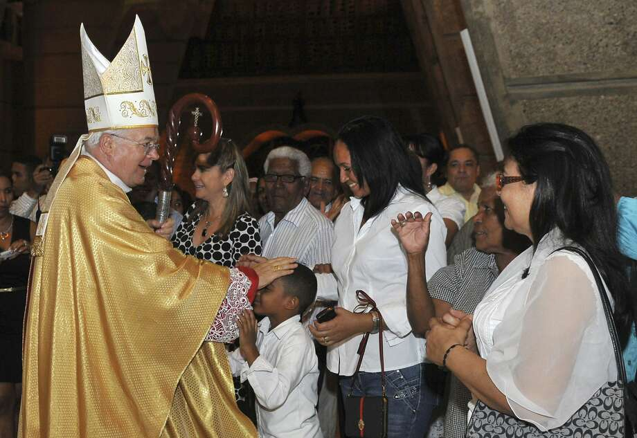FILE -- In this March 15, 2013 photo, Archbishop Josef Wesolowski, papal nuncio for the Dominican Republic, greets people after a Mass in Santo Domingo, Dominican Republic. Wesolowski has been convicted by a church tribunal of sex abuse and has been defrocked, the first such sentence handed down against a top papal representative, the Vatican said Friday, June 27, 2014. (AP Photo/Manuel Diaz) Photo: Manuel Diaz, Associated Press