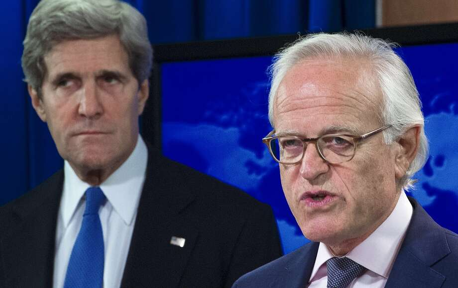 (FILES) US Secretary of State John Kerry listens during a press conference at the State Department in this July 29, 2013, file photo after announcing former US ambassador to Israel, Martin Indyk (R), will head the Israeli-Palestinian peace talks in Washington, DC. Indyk resigned on June 27, 2014 after the collapse of peace talks. Kerry, announcing the resignation in a statement through a spokeswoman, said Indyk would return to his position at the Brookings Institution think tank.     AFP PHOTO/Paul J. Richards/FILESPAUL J. RICHARDS/AFP/Getty Images Photo: Paul J. Richards, AFP/Getty Images
