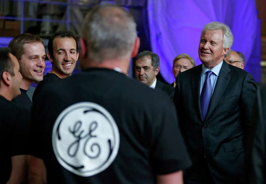General Electric Chairman and CEO Jeffrey Immelt (R) chats with employees during a visit at the gas turbines production unit of the GE plant in Belfort, June 24, 2014. France won an option to buy 20 percent of Alstom from conglomerate Bouygues last week, in an eleventh-hour deal clearing the way for the agreed sale of most of Alstom's energy business to GE. REUTERS/Vincent Kessler Photo: VINCENT KESSLER, REUTERS / Stamford Advocate Contributed