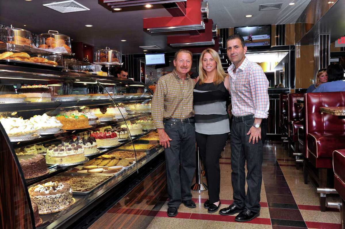 Owners of the Dinerlux in New Milford, Conn. from left, Peter Saisanas, his daughter, Maria and Peter Gus Serroukas are photographed Friday, June 27, 2014.