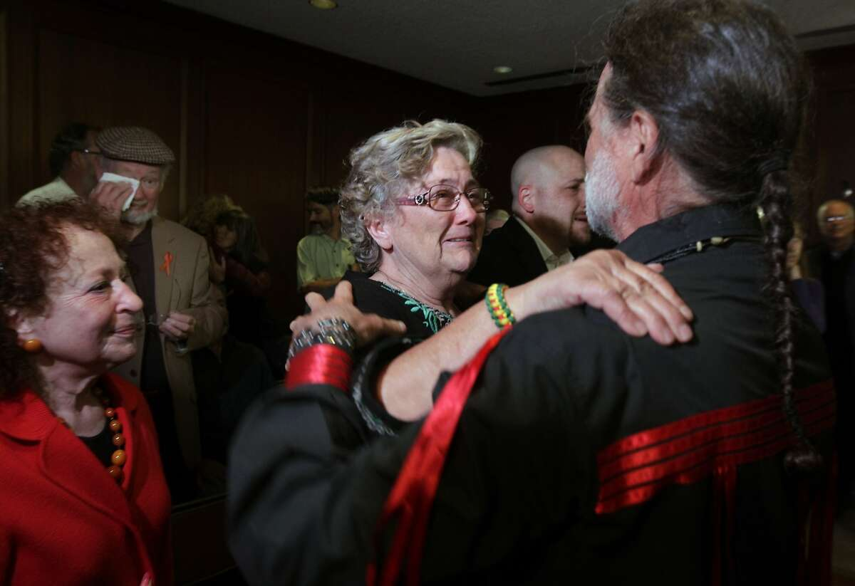 Sue Story (center) embraces Dana Barks after the Golden Gate Bridge District board of directors vote unanimously in favor of erecting a suicide barrier on the iconic bridge in San Francisco, Calif. on Friday, June 27, 2014. Story's son Jacob took his own life after jumping from the bridge in 2010 and Barks' son Donovan died after he jumped in 2008.