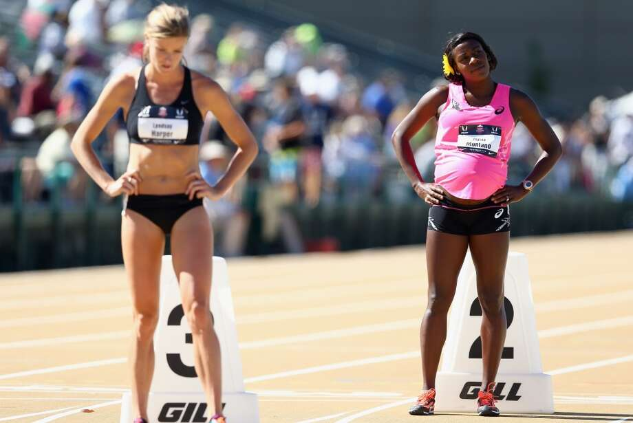 A pregnant Alysia Montano waits to run in the opening round of the Women's 800 Meter on day 2 of the USATF Outdoor Championships at Hornet Stadium on June 26, 2014 in Sacramento, California. Photo: Andy Lyons, Getty Images