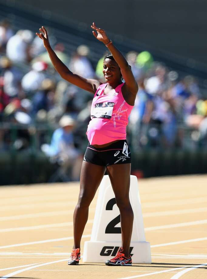 A pregnant Alysia Montano waves to the crowd before running in the opening round of the Women's 800 Meter on day 2 of the USATF Outdoor Championships at Hornet Stadium on June 26, 2014 in Sacramento, California. Photo: Andy Lyons, Getty Images