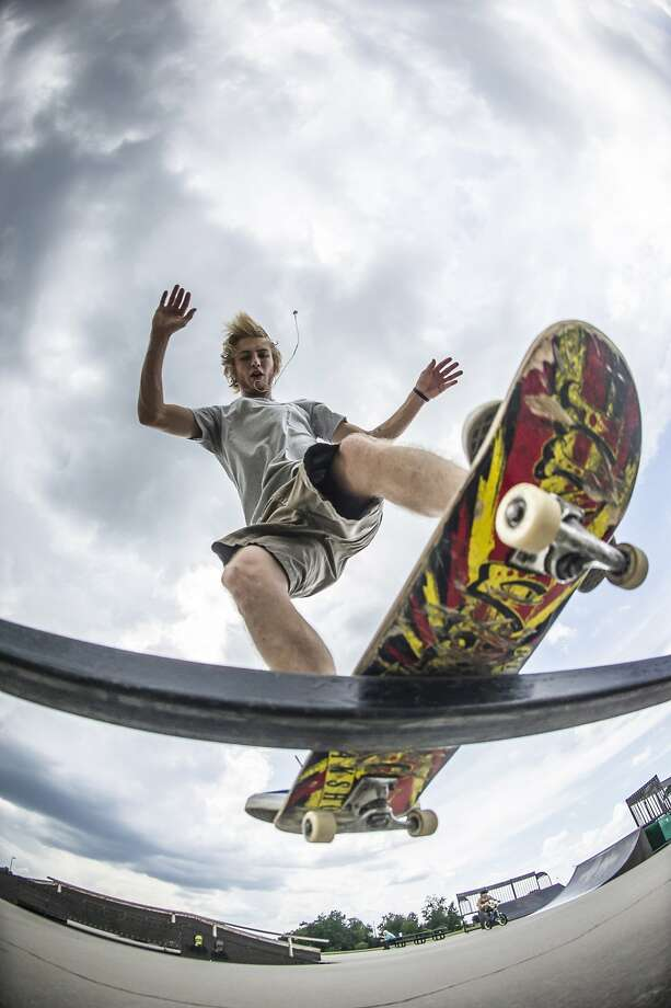 Really hoping he doesn't land on the photographer: James Todd does a board slide in Millennium 