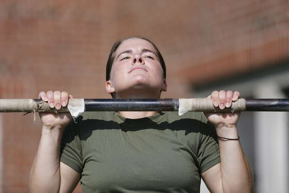 The pullup question: Sarah Burns clears the bar as she executes a proper pullup while 