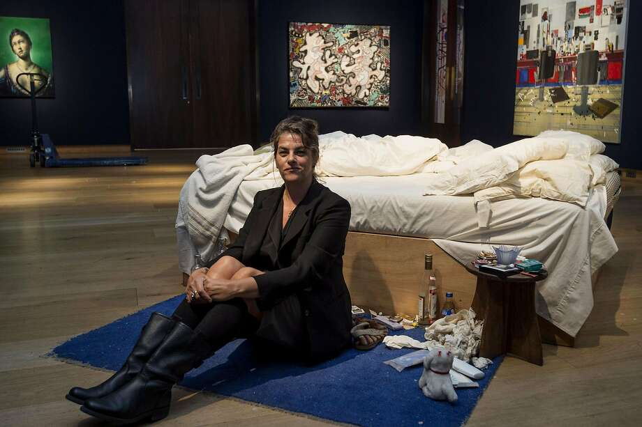 """Anyone want to bid on our sofa artfully littered with Cheetos and cat hair?British   artist Tracey Emin sits on her iconic installation, """"My Bed"""" at Christie's auction house.   Emin's unmade bed, artfully littered with condoms, cigarette packs and underwear, is expected to   fetch around $1.7 million at auction. Photo: Niklas Halle'n, AFP/Getty Images"""
