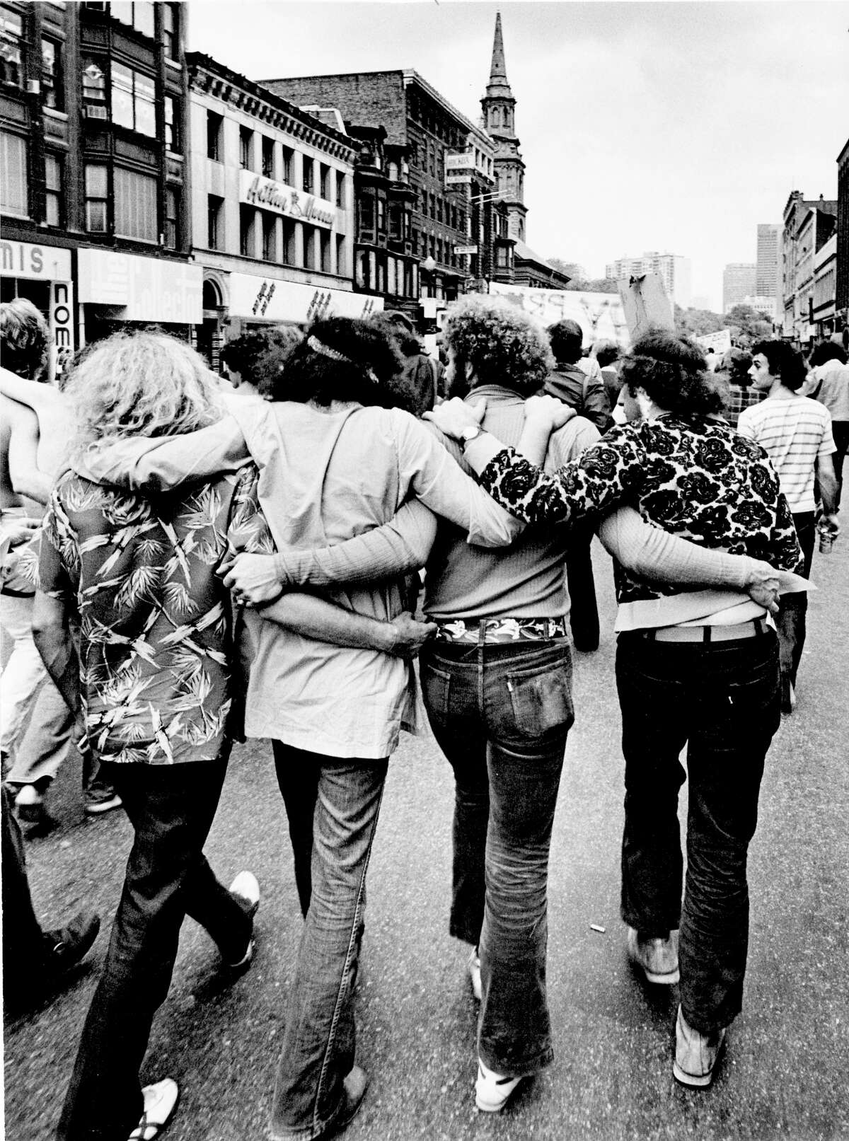 1972: Camaraderie in the streets during a gay pride parade in Boston, Mass.