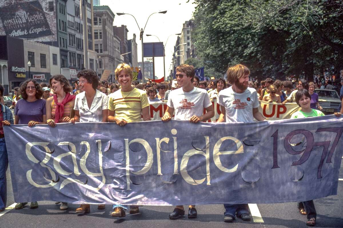 1977: Holding a banner during a gay pride parade in Boston, Mass.