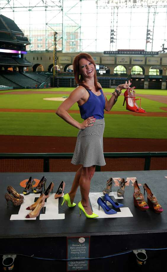 Julia Morales the Houston Astros field reporter for Comcast SportsNet Houston wears her orange-red high heels during an on-air broadcast, on the warning track, before the start of the Astros-Nationals game at Minute Maid Park, Wednesday, April 30, 2014, in Houston. ( Karen Warren / Houston Chronicle  ) Photo: Karen Warren, Staff / © 2014 Houston Chronicle