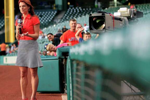 Julia Morales the Houston Astros field reporter for Comcast SportsNet Houston wears her orange-red high heels during an on-air broadcast, on the warning track, before the start of the Astros-Nationals game at Minute Maid Park, Wednesday, April 30, 2014, in Houston. ( Karen Warren / Houston Chronicle  )