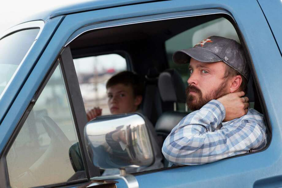 "Aaron Paul, right, stars as Hollis Wilson and Houston native Josh Wiggins stars as Jacob Wilson in ""Hellion."" Photo: Lauren Logan"