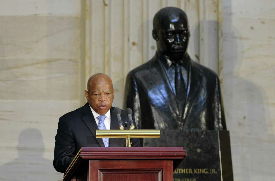 Rep. John Lewis, D-Ga., with the backdrop of a statue of  Martin Luther King Jr., speaks  at a 50th anniversary ceremony for the Civil Rights Act of 1964. Lewis was among those who were steadfast in pursuing civil rights for minorities, rights denied to many until 1964. Photo: Susan Walsh / Associated Press / AP