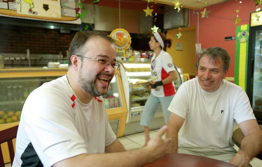 Joe Guimaraes, 49, of Carmel, New York,  was in Banana Brazil Luncheonette, on Main Street in Danbury, Conn, with Joe Sarmento, 56, of Danbury, talking about Brazil and World Cup soccer, on Friday, June 27, 2014. Photo: H John Voorhees III / The News-Times Freelance