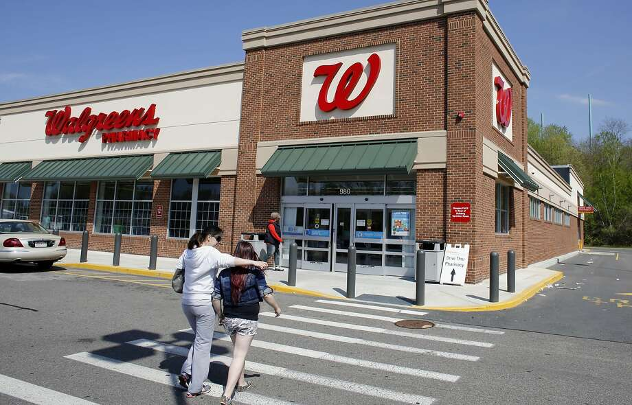 Could Walgreens be a corporate citizen of Switzerland soon? Photo: Steven Senne, Associated Press