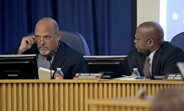 Tom Neild and Timothy Chargois during Thursday's Beaumont Independent School District's meeting. The board addressed spending and employees during the session.