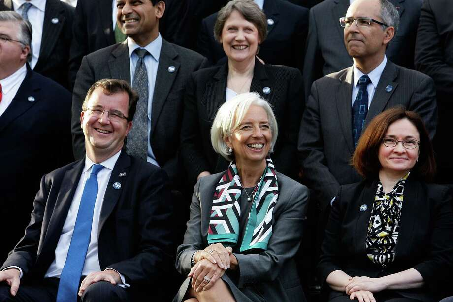 SYDNEY, AUSTRALIA - FEBRUARY 22:  World Bank Chief Financial Officer Bertrand Badre, International Monetary Fund (IMF) chief Christine Lagarde and Russian Central Bank Governor Elvira Nabiullina wait for the G20 Finance Ministers and Central Bank Governors official group photo to be taken on February 22, 2014 in Sydney, Australia. This event is the first major G20 meeting under Australia's presidency in 2014.  (Photo by Lisa Maree Williams/Getty Images) Photo: Lisa Maree Williams, Stringer / 2014 Getty Images