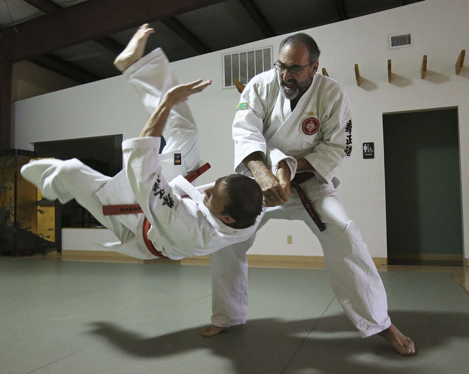 Winslow Swart performs a  maneuver with Von Shields at his kenseido training center in San Antonio. Swart leaves for Japan on Sunday in an effort to ascend to the highest rank of the martial art masters. His trials will last a week there. Photo: Photos By Tom Reel / San Antonio Express-News