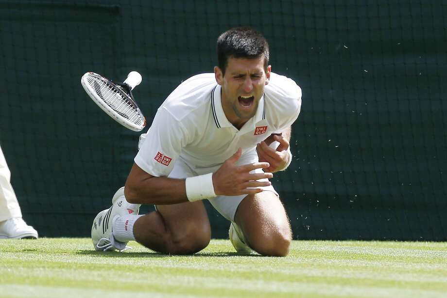 Novak Djokovic injures his left arm, but it wasn't enough to prevent him from advancing. Photo: Sang Tan, Associated Press