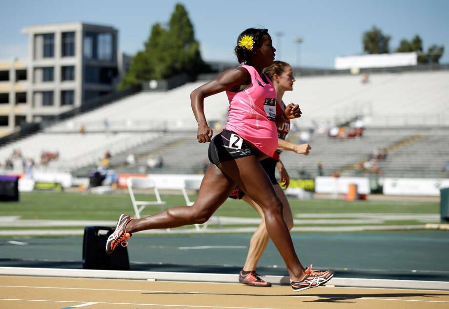 A pregnant Alysia Montano runs in the opening round of the women's 800 meter run during day 2 of the USATF Outdoor Championships at Hornet Stadium on June 26, 2014 in Sacramento, California. Photo: Ezra Shaw, Getty Images