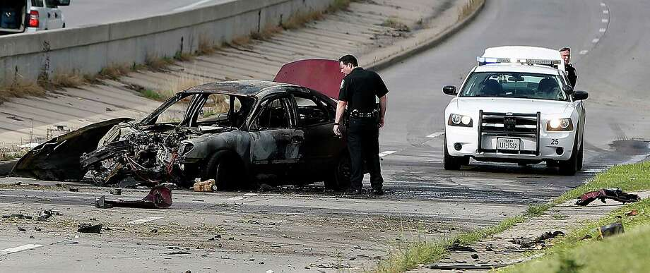 This is what's left of a vehicle that caught fire during a crash on the feeder road at Loop 610 near Broadway on Friday afternoon. It all started with a police chase, City of South Houston police tell KTRK.  Photo: Karen Warren, Houston Chronicle / © 2014 Houston Chronicle