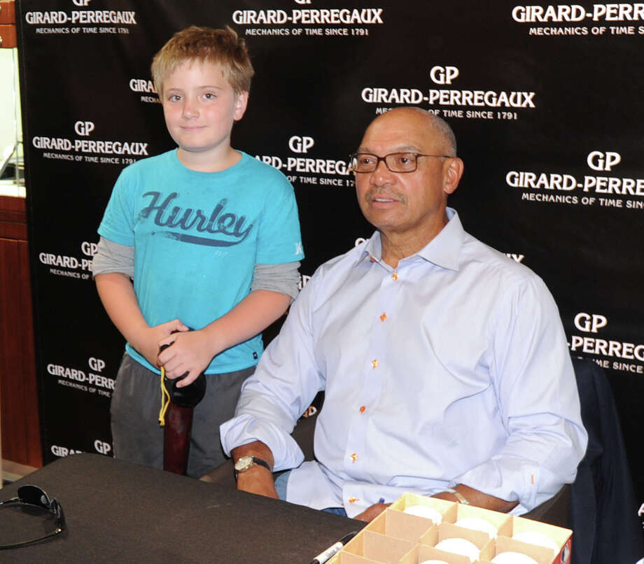 "At left, Alberto Cantalini, 10, of Greenwich, with New York Yankee baseball legend, Reggie Jackson, during an appearance by Jackson at the Manfredi Jewels store on Greenwich Avenue, Greenwich, Conn., Friday, June 27, 2014. Jackson, also known as ""Mr. October"" for his home run prowess when it mattered, was at the store for the unveiling of the Constant Escapement L.M., a revolutionary timepiece created in collaboration with Jackson and Swiss watch brand, Girard-Perragaux. Photo: Bob Luckey / Greenwich Time"
