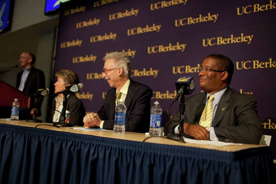 Michael Williams, right, attends a press conference announcing his new position as Interim Director of Athletics after the former Director of Athletics Sandy Barbour, at left, announced her change of position at California Memorial Stadium at the University of California, Berkeley on Friday, June 26, 2014. Photo: TIM HUSSIN / ONLINE_YES