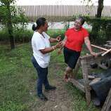 June 26, 2014, 8:18 p.m., Brownsville, Texas - Brownsville residents Elizabeth Garcia (left) and Elisa Cortez chat in Cortez's backyard which was shortened due to the placement of a border fence. Cortez lives about a mile from the Rio Grande River which borders Mexico.