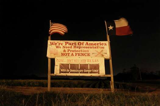 June 26, 2014, 9:56 p.m., Brownsville, Texas - Signage near the intersection of Monsees Road and Milpa Verde in Cameron County just south of Brownsville displays opposition to the existing border fence that was built in the area. Photo: Kin Man Hui, San Antonio Express-News / ©2014 San Antonio Express-News