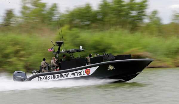 JUNE 25, 2014, 1:34 PM, MISSION, TEXAS - A boat from the Texas Department of Public Safety Marine Unit patrols the Rio Grande upriver from Anzalduas Dam, Wednesday, June 25, 2014. A strong presence on land and water by units from the Department of Public Safety is visible in Hidalgo and Starr County in responds to a wave of immigrants from Central America. Photo: Jerry Lara, San Antonio Express-News / ©2014 San Antonio Express-News